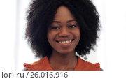 Купить «happy smiling african american young woman face», видеоролик № 26016916, снято 22 марта 2017 г. (c) Syda Productions / Фотобанк Лори