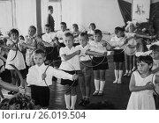 Купить «Дети делают упражнения с обручами в детском саду. 1967-68 год.», эксклюзивное фото № 26019504, снято 19 апреля 2017 г. (c) Светлана Попова / Фотобанк Лори