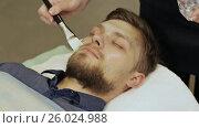 Купить «Applying cream-mask. Massage the face and neck. Bearded man.», видеоролик № 26024988, снято 21 марта 2017 г. (c) Mikhail Davidovich / Фотобанк Лори