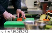 Купить «hands of male chef cook chopping carrot in kitchen», видеоролик № 26025372, снято 18 августа 2019 г. (c) Syda Productions / Фотобанк Лори