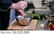 Купить «hands of male chef cook breaking eggs in kitchen», видеоролик № 26025388, снято 19 июля 2019 г. (c) Syda Productions / Фотобанк Лори