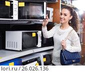 Купить «Woman choosing new microwave», фото № 26026136, снято 13 ноября 2019 г. (c) Яков Филимонов / Фотобанк Лори