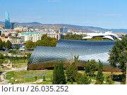Купить «View of Rike Park with Public Service Hall in Tbilisi, Georgia», фото № 26035252, снято 27 сентября 2016 г. (c) Elena Odareeva / Фотобанк Лори