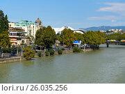 Купить «View bank of Kura river with Public Service Hall», фото № 26035256, снято 22 сентября 2016 г. (c) Elena Odareeva / Фотобанк Лори