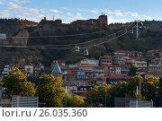 Купить «View on cableway under roofs of Old city at sunset. Tbilisi, Georgia», фото № 26035360, снято 25 сентября 2016 г. (c) Elena Odareeva / Фотобанк Лори