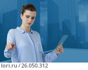 Купить «Woman touching air while holding glass tablet with blue city buildings background», фото № 26050312, снято 20 июня 2019 г. (c) Wavebreak Media / Фотобанк Лори