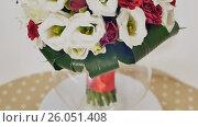 Купить «Wedding bouquet of rose bush, eustoma and greens. Bouquet in rotation.», видеоролик № 26051408, снято 22 апреля 2017 г. (c) Mikhail Davidovich / Фотобанк Лори