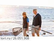 Купить «Senior man fishing with his grandson», фото № 26051908, снято 15 апреля 2015 г. (c) Sergey Nivens / Фотобанк Лори