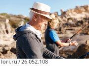 Купить «Senior man fishing with his grandson», фото № 26052108, снято 15 апреля 2015 г. (c) Sergey Nivens / Фотобанк Лори