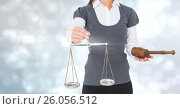 Купить «Judge with balance scale and hammer in front of lights», фото № 26056512, снято 23 февраля 2020 г. (c) Wavebreak Media / Фотобанк Лори