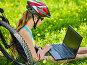 Woman traveling bicycle in summer park. Girl watch laptop., фото № 26058368, снято 6 апреля 2016 г. (c) Gennadiy Poznyakov / Фотобанк Лори