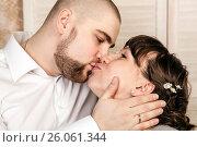 Купить «Man and woman kissing at the wedding», фото № 26061344, снято 26 февраля 2016 г. (c) Александр Калугин / Фотобанк Лори