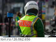 Купить «BERLIN - APRIL 03, 2016: The annual Berlin Half Marathon. Before the start of the race. A police officer on a motorcycle escort.», фото № 26062656, снято 3 апреля 2016 г. (c) Sergey Kohl / Фотобанк Лори