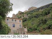 Купить «MONTSERRAT, SPAIN - AUGUST 28, 2012: The station of funicular santa Cova at the Benedictine abbey Santa Maria de Montserrat in Monistrol de Montserrat, Spain», фото № 26063264, снято 28 августа 2012 г. (c) Шилер Анастасия / Фотобанк Лори