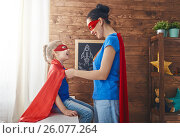 Купить «Girl and mom in Superhero costume», фото № 26077264, снято 7 апреля 2017 г. (c) Константин Юганов / Фотобанк Лори