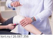 Купить «Traumatologist is taking care of the patient», фото № 26087356, снято 9 февраля 2017 г. (c) Elnur / Фотобанк Лори