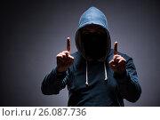 Купить «Man wearing hood in dark room», фото № 26087736, снято 2 декабря 2016 г. (c) Elnur / Фотобанк Лори