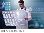 Купить «Male doctor studying results of brain mri scan», фото № 26087824, снято 21 мая 2020 г. (c) Elnur / Фотобанк Лори