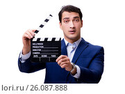 Купить «Handsome man with movie clapper isolated on white», фото № 26087888, снято 5 ноября 2016 г. (c) Elnur / Фотобанк Лори