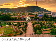 Купить «View of Rike Park with Bridge of Peace at sunset. Tbilisi, Georgia», фото № 26104864, снято 25 сентября 2016 г. (c) Elena Odareeva / Фотобанк Лори