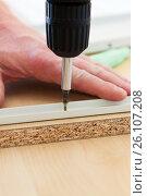 Купить «Man screwing screws», фото № 26107208, снято 26 марта 2013 г. (c) Анна Гучек / Фотобанк Лори
