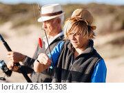 Купить «Senior man fishing with his grandson», фото № 26115308, снято 15 апреля 2015 г. (c) Sergey Nivens / Фотобанк Лори