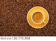 Espresso yellow cup and saucer on coffee beans. Стоковое фото, фотограф Anton Eine / Фотобанк Лори