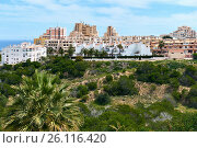 Typical spanish coastal urbanization of La Mata town. La Mata is a small town located 5 km northeast of Torrevieja along the Costa Blanca, Province of Alicante. Spain (2017 год). Стоковое фото, фотограф Alexander Tihonovs / Фотобанк Лори