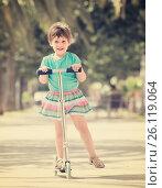 Купить «Little girl with scooter», фото № 26119064, снято 7 июня 2014 г. (c) Яков Филимонов / Фотобанк Лори