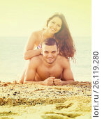 Купить «Loving man and his girlfriend on sand beach», фото № 26119280, снято 25 июня 2014 г. (c) Яков Филимонов / Фотобанк Лори