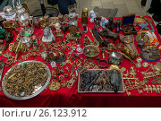 Купить «Moscow, Russia - March 19, 2017: Bronze, brass handmade souvenirs are spread out on the table mixed with antiques», фото № 26123912, снято 19 марта 2017 г. (c) Андрей Копылов / Фотобанк Лори