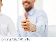 Купить «hand of smiling businessman showing thumbs up», фото № 26141716, снято 10 мая 2014 г. (c) Syda Productions / Фотобанк Лори