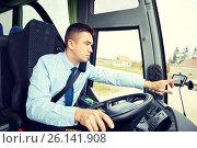 Купить «bus driver entering address to gps navigator», фото № 26141908, снято 21 октября 2015 г. (c) Syda Productions / Фотобанк Лори