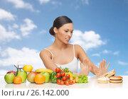 Купить «woman with fruits rejecting fast food», фото № 26142000, снято 12 января 2013 г. (c) Syda Productions / Фотобанк Лори