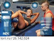 Купить «woman with personal trainer doing sit ups in gym», фото № 26142024, снято 19 апреля 2015 г. (c) Syda Productions / Фотобанк Лори