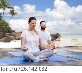 People meditating in yoga lotus pose outdoors. Стоковое фото, фотограф Syda Productions / Фотобанк Лори