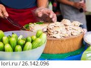 Купить «cook with poultry and cucumbers at street market», фото № 26142096, снято 7 февраля 2015 г. (c) Syda Productions / Фотобанк Лори