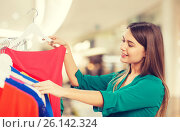 Купить «happy woman choosing clothes at home wardrobe», фото № 26142324, снято 19 февраля 2016 г. (c) Syda Productions / Фотобанк Лори
