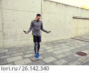 Купить «man exercising with jump-rope outdoors», фото № 26142340, снято 17 октября 2015 г. (c) Syda Productions / Фотобанк Лори