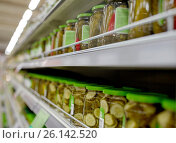 Купить «jars of pickles on grocery or supermarket shelves», фото № 26142520, снято 2 ноября 2016 г. (c) Syda Productions / Фотобанк Лори