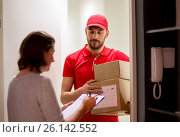 Купить «deliveryman and customer with parcel boxes at home», фото № 26142552, снято 3 декабря 2016 г. (c) Syda Productions / Фотобанк Лори