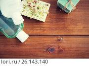 Купить «close up of handmade soap bars and lotions on wood», фото № 26143140, снято 21 декабря 2015 г. (c) Syda Productions / Фотобанк Лори