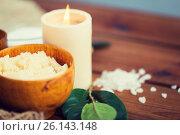 Купить «close up of natural body scrub and candle on wood», фото № 26143148, снято 21 декабря 2015 г. (c) Syda Productions / Фотобанк Лори