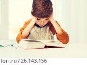 Купить «student boy reading book or textbook at home», фото № 26143156, снято 24 октября 2015 г. (c) Syda Productions / Фотобанк Лори