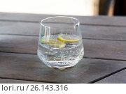 Купить «glass with cold water or cocktail on bar table», фото № 26143316, снято 11 февраля 2016 г. (c) Syda Productions / Фотобанк Лори