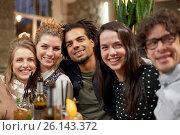 Купить «happy friends with drinks at bar or cafe», фото № 26143372, снято 19 ноября 2016 г. (c) Syda Productions / Фотобанк Лори