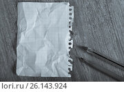 Купить «Crumpled torn page», фото № 26143924, снято 21 сентября 2018 г. (c) Яков Филимонов / Фотобанк Лори