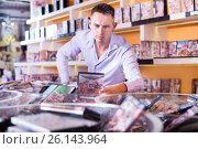 Man buying erotic films in sex shop. Стоковое фото, фотограф Яков Филимонов / Фотобанк Лори