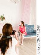 Купить «Female model and photographer in a photoshooting», фото № 26145248, снято 7 июля 2020 г. (c) Чебеляев Геннадий / Фотобанк Лори