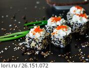 Japanese sushi roll set on black background. Стоковое фото, фотограф Галина Жигалова / Фотобанк Лори